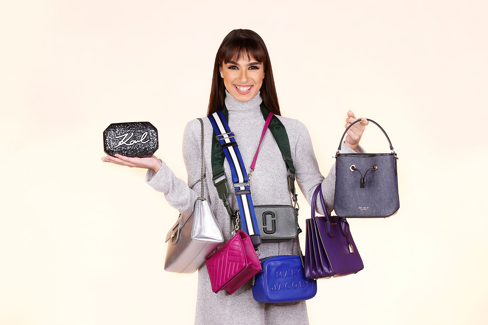 A Model carrying rented bags from Vie trendy